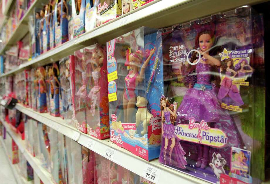 FILE -In this Monday, July 16, 2012, file photo, Barbie products are displayed at a local toy store in Hialeah, Fla. Mattel Inc. reports quarterly financial results before the market opens on Wednesday, April 17, 2013. (AP Photo/Alan Diaz) Photo: Alan Diaz, STF / AP