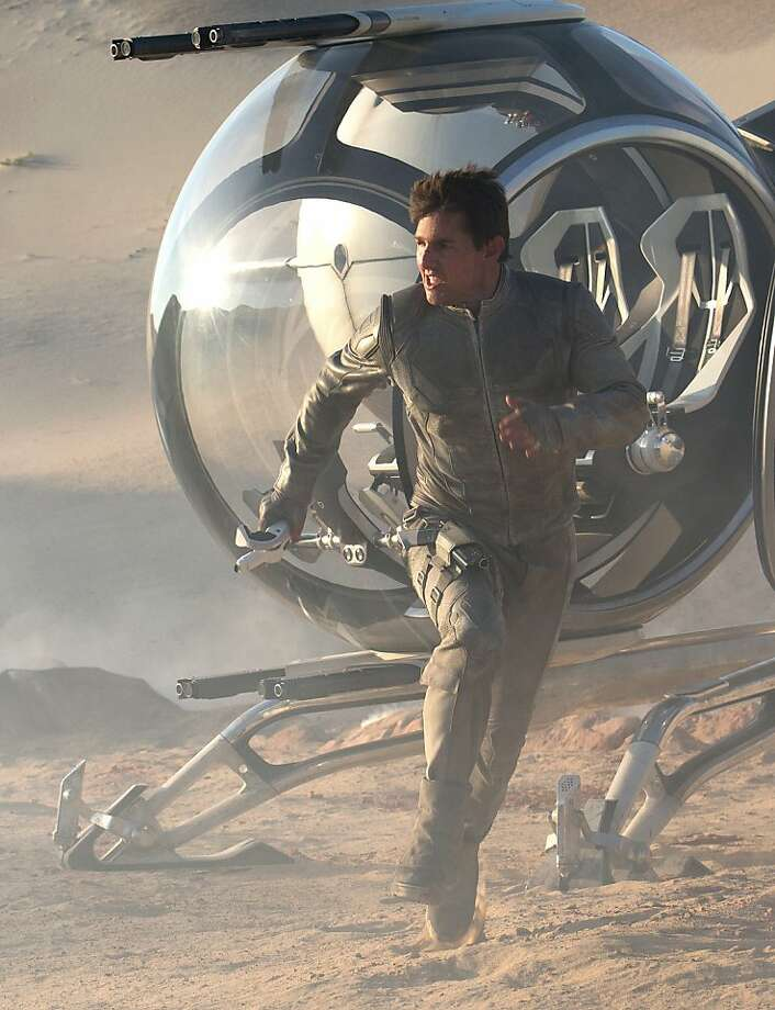 "Tom Cruise plays Jack Harper, assigned to a last mission on the devastated Earth in 2077, in ""Oblivion."" Photo: David James, Universal Pictures"