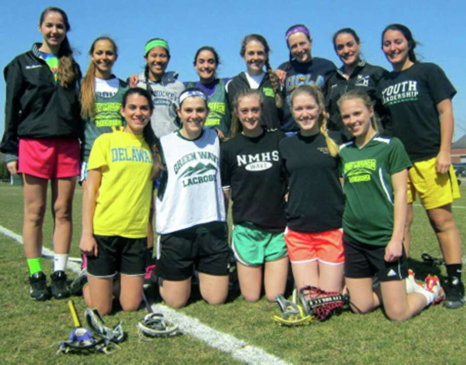 A dozen-strong seniors grace the New Milford High School girls' lacrosse roster this spring. They are, from left to right, front row, Chrsitina Munoz, Julia Waldman, Jordan Brown, Cailin McLaughlin and Claudia Taylor; and, back row, Alex McGowan, Maria Giokas, Kristi Montemurro, Alexa Carey, Madeline Phillips, Olivia Monteiro, Destinee Carey and Kelly Claire. April 2013 Photo: Norm Cummings