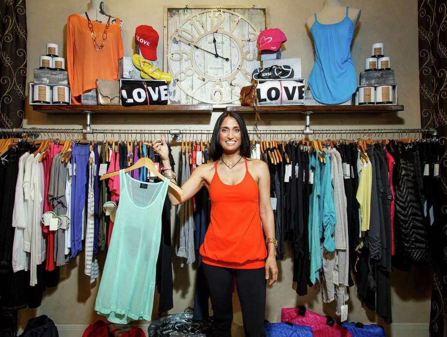 Owner Valerie Horwitz poses for a portrait in her store, Mighty Aphrodity, which caters towards moderate to high-end fitness and lounge wear, Tuesday, April 9, 2013, in Houston.  ( Michael Paulsen / Houston Chronicle ) Photo: Michael Paulsen, Staff / © 2013 Houston Chronicle