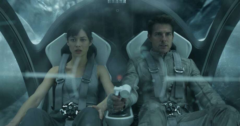 "As astronauts on an uninhabitable Earth, Olga Kurylenko and Tom Cruise lead a strong cast that salvages ""Oblivion."" Photo: Universal Pictures"