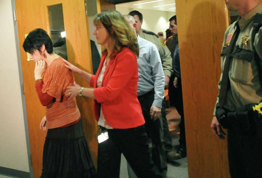 Aaron Schauffhausen's ex-wife Jessica, far left, is hustled out of the courtroom after a jury rejected Aaron Schauffhausen's insanity defense in the killing of the couple's three daughters at the conclusion of his two-week trial at the St. Croix County courthouse in Hudson, Wis., on Tuesday April 16, 2013. (AP Photo/Pioneer Press, John Doman) Photo: John Doman