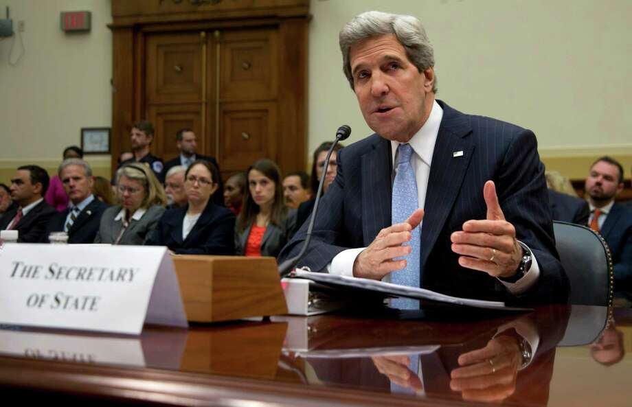 Secretary of State John Kerry testifies on Capitol Hill in Washington, Wednesday, April 17, 2013, before the House Foreign Affairs Committee hearing on the State Department's fiscal 2014 foreign affairs budget.  (AP Photo/Carolyn Kaster) Photo: Carolyn Kaster