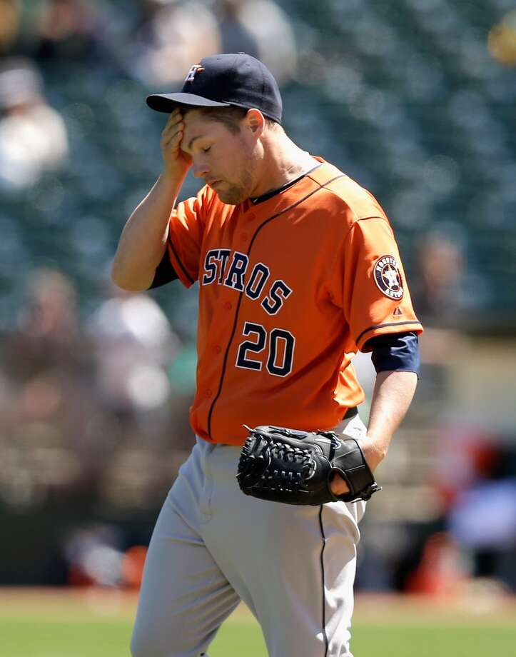 April 17: A's 7, Astros 5 Astros starting pitcher Bud Norris wipes sweat from his face after walking Shane Peterson of Oakland and loaded the bases. Photo: Ezra Shaw, Getty Images