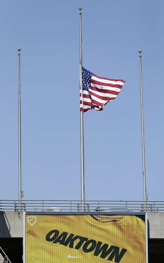 A flag at half mast at O.co Coliseum during the Astros matchup with the Athletics. Photo: Jeff Chiu, Associated Press