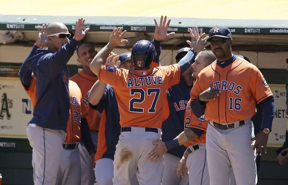 Jose Altuve of the Astros celebrates a run scored in the first inning. Photo: Jeff Chiu, Associated Press