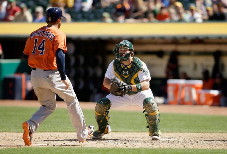 Derek Norris of the Athletics waits to tag out J.D. Martinez of the Astros in the seventh inning. Photo: Ezra Shaw, Getty Images