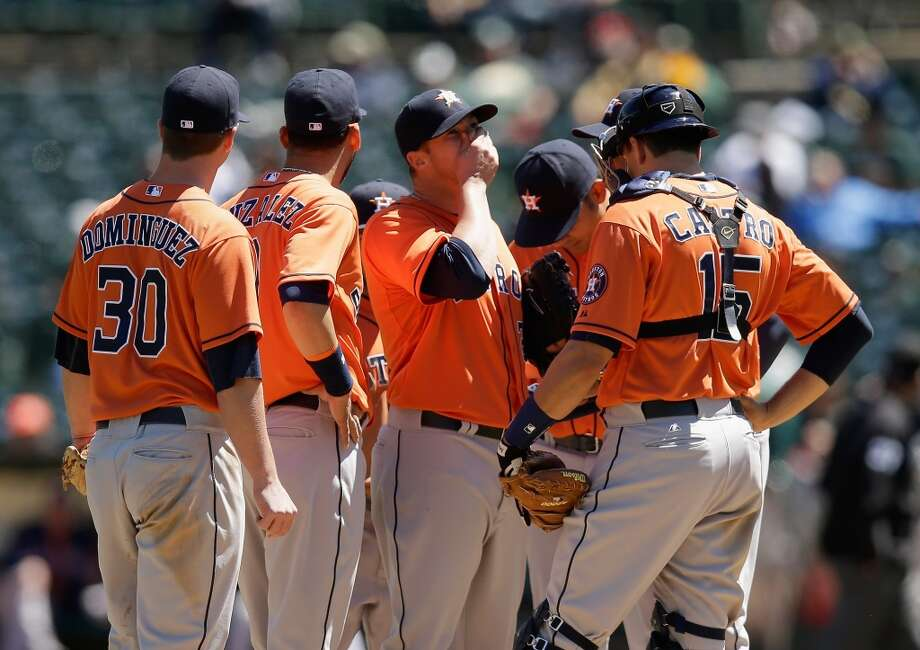 Astros pitcher Bud Norris is taken out of the game during the first inning. Photo: Ezra Shaw, Getty Images