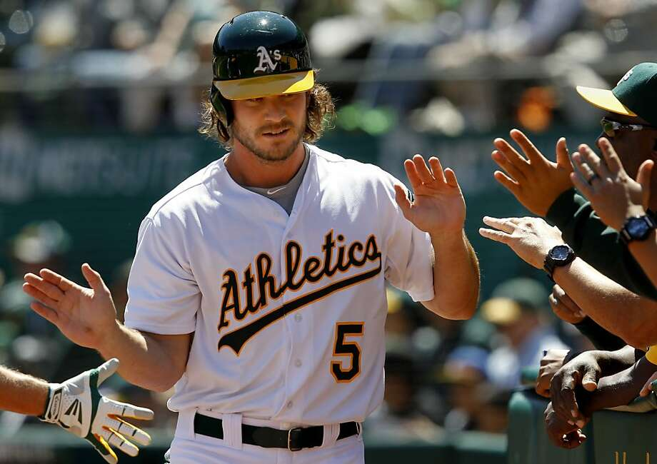 John Jaso scored the first of the A's runs in the first inning. The Oakland A's against the Houston Astros Wednesday April 17, 2013 at O.co Coliseum. Photo: Brant Ward, The Chronicle