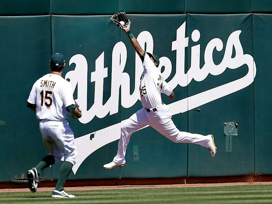 Chris Young (25) makes a nice catch to end the 5th inning on a drive by Marwin Gonzalez. The Oakland A's against the Houston Astros Wednesday April 17, 2013 at O.co Coliseum. Photo: Brant Ward, The Chronicle