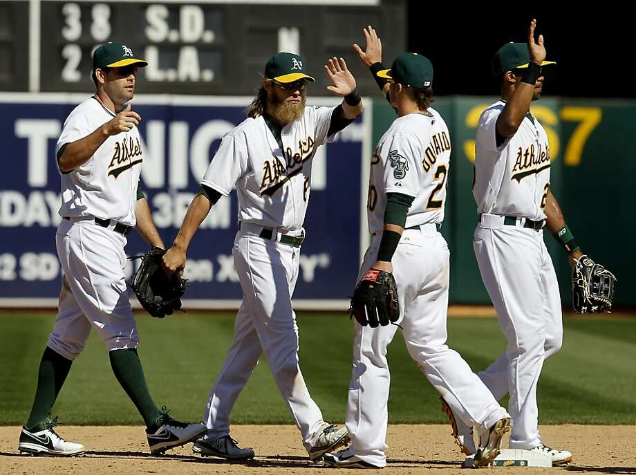 The Athletics celebrated their 7-5 victory over Houston. The Oakland A's against the Houston Astros Wednesday April 17, 2013 at O.co Coliseum. Photo: Brant Ward, The Chronicle