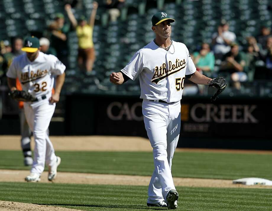 Grant Balfour saved the game after giving up a home run in the 9th inning. The Oakland A's against the Houston Astros Wednesday April 17, 2013 at O.co Coliseum. Photo: Brant Ward, The Chronicle
