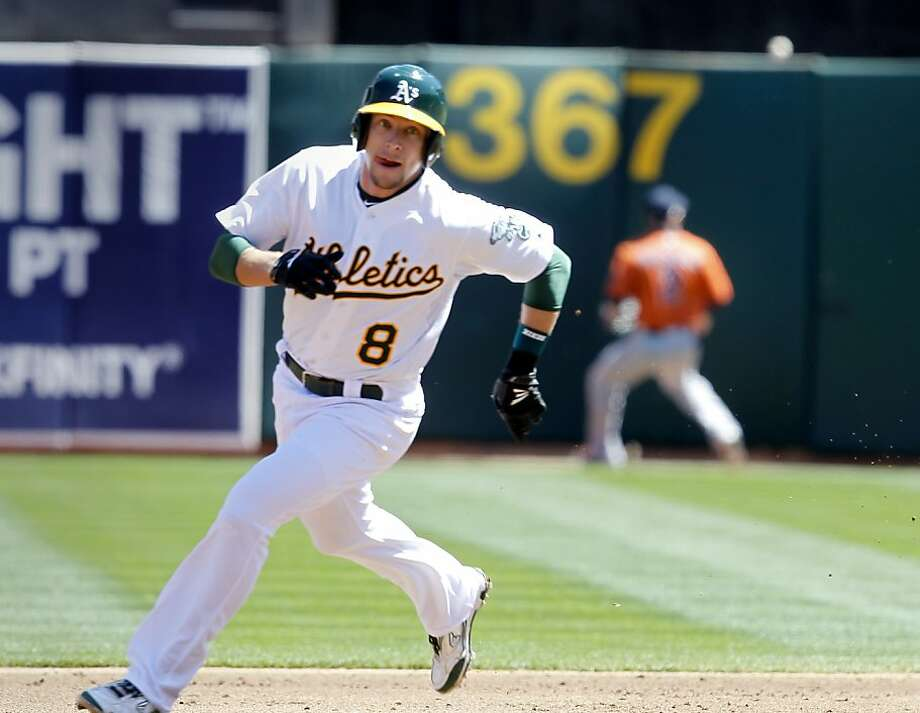 Jed Lowrie rounds the bases in the first inning after a hit by Josh Reddick scored two. The Oakland A's against the Houston Astros Wednesday April 17, 2013 at O.co Coliseum. Photo: Brant Ward, The Chronicle
