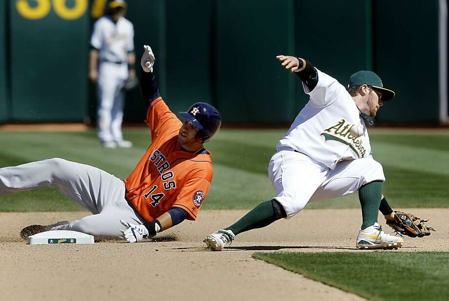 The A's Eric Sogard can't handle a throw and J.D. Martinez reaches second in the 7th inning. The Oakland A's against the Houston Astros Wednesday April 17, 2013 at O.co Coliseum. Photo: Brant Ward, The Chronicle