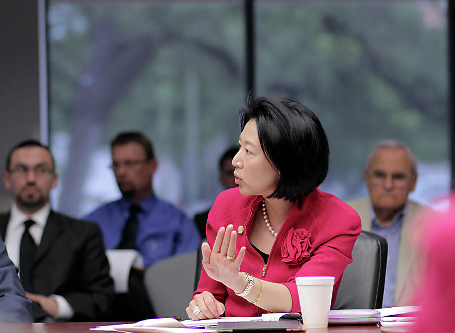 City Councilwoman Elisa Chan asks City Attorney Michael Bernard a question Wednesday, April 17, 2013, about proposed changes to the city's ethics code. Photo: John Tedesco, San Antonio Express-News / San Antonio Express-News