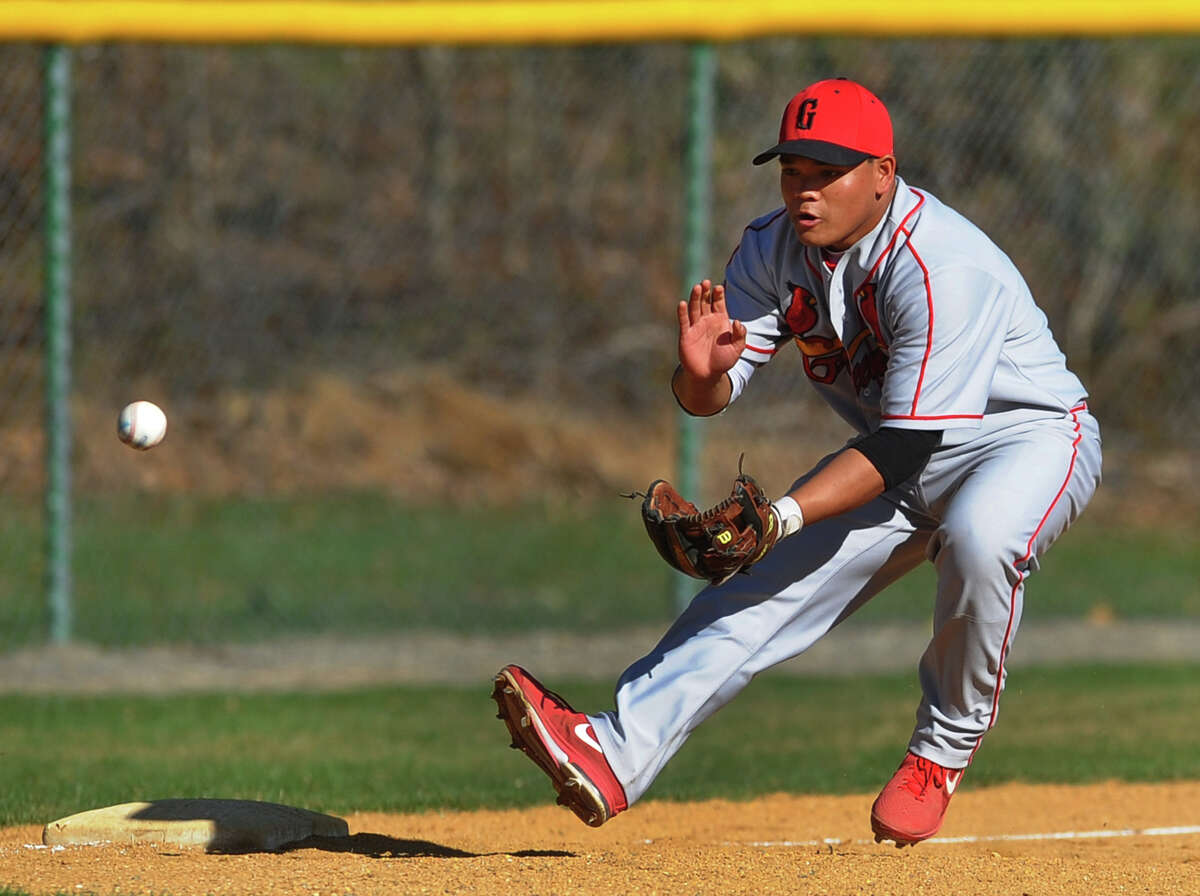 Greenwich's Cameron Fennell fields a St. Joseph grounder, during baseball action in Trumbull, Conn. on Wednesday April 17, 2013.