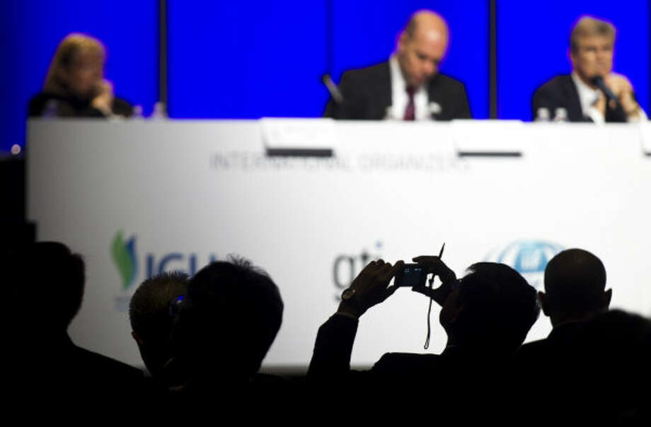 A delegate takes a photo during a panel discussion on the role of LNG in the growing global gas demand during the 17th International Conference & Exhibition on Liquefied Natural Gas at the George R. Brown Convention Center Wednesday, April 17, 2013, in Houston. Photo: Brett Coomer, Houston Chronicle