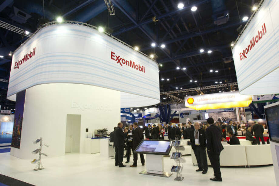 Visitors browse the ExxonMobil booth during the 17th International Conference & Exhibition on Liquefied Natural Gas at the George R. Brown Convention Center Wednesday, April 17, 2013, in Houston. Photo: Brett Coomer, Houston Chronicle
