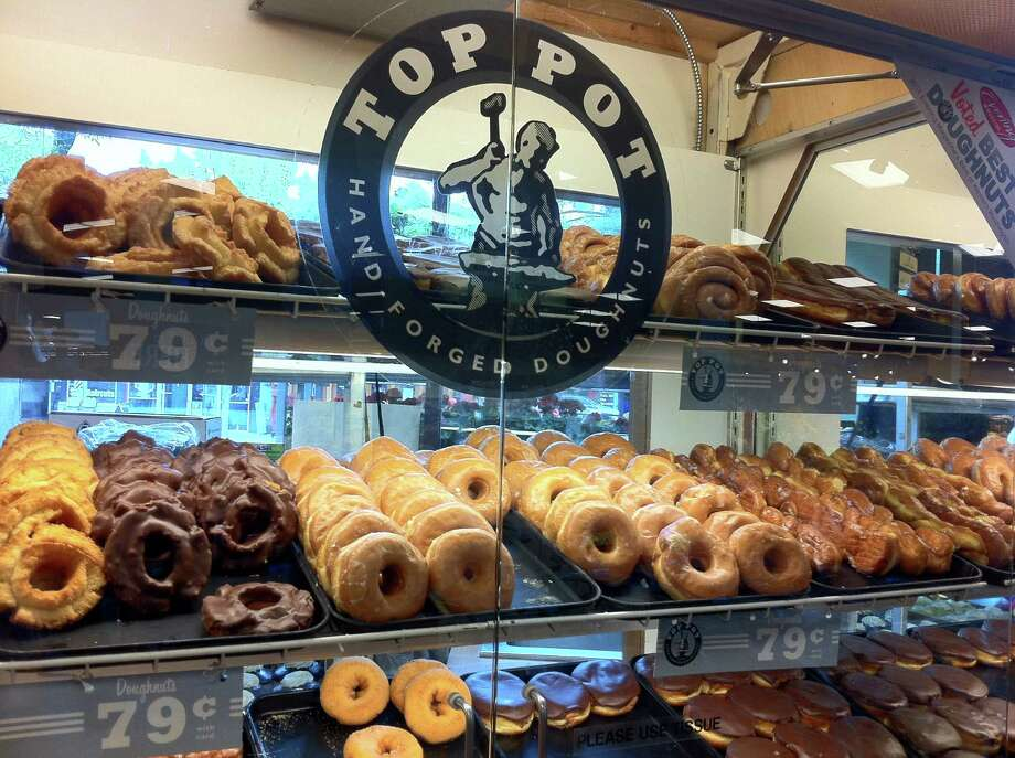 Top Pot doughnuts are available in 68 QFCs from Stanwood to Portland. Why are they cheaper at QFC than in a Top Pot shop? They're slighter smaller at QFC, says Klebeck. And you can't get all the varieties. Photo: Vanessa Ho / seattlepi.com