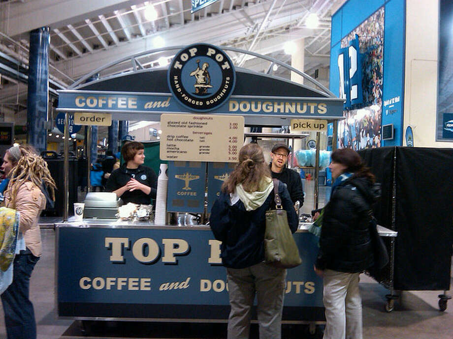 For people who can't make it through a Seahawks or Sounders game without sugar and caffeine: Top Pot became the official doughnuts and coffee provider for Qwest CenturyLink Field in 2010. Photo by  HeatherHeatherHeather, Flickr. Photo: Photo By