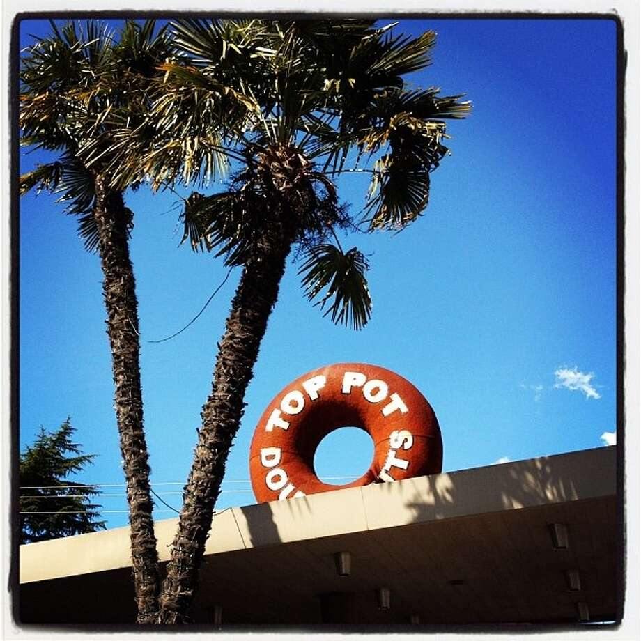 Top Pot's third store, in Wedgwood, is at a former service station. It's known for its giant, rooftop doughnut and palm trees that don't mind Seattle's gloomy weather. (They're frost-resistant). Photo by Dave Sizer, Flickr.