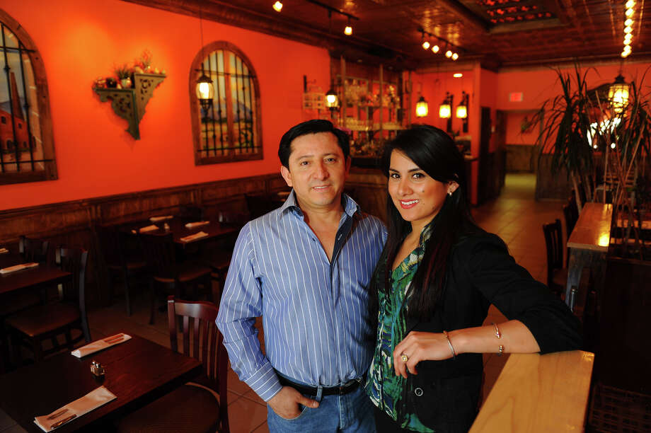 Hacienda Villa owners Alvino Villa and Jessica Nunez pose inside the restaurant which is located on Fairfield Avenue in Bridgeport, Conn. on Wednesday April 17, 2013. Photo: Christian Abraham / Connecticut Post