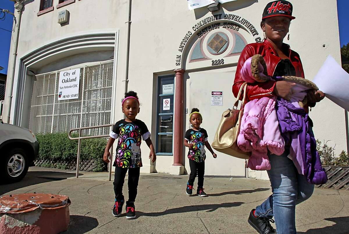 Kanica Richard picks up her twin 3-year-old daughters, Chloe,(left) and Chaya from the Head Start San Antonio Community Development Center which is being proposed for closure. Oakland Mayor Jean Quan and City Administrators released their budget proposal for the City of Oakland, at City Hall in downtown Oakland, Ca. on Wednesday April 18, 2013.