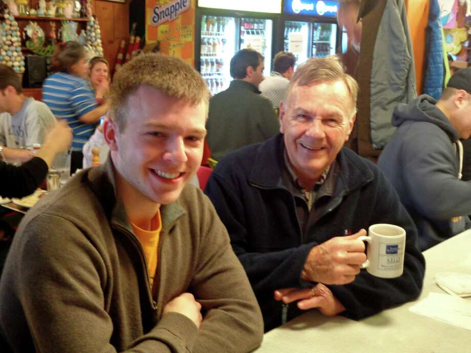Spencer Matson, at left, with Bob Dennis at the Sugar Bowl. Matson and Dennis meet for breakfast when Matson comes home from school. Matson will be biking 4,000 miles cross country this summer. Photo: Contributed