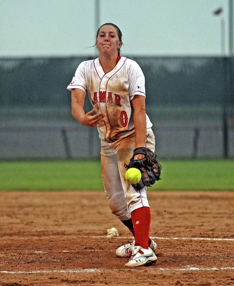 Lamar pitcher Tina Schulz, #10, hurls a fast ball during the sixth inning of the Lamar University Lady Cardinals softball game against Texas Souther Lady Tigers on Wednesday, April 17, 2013, at Ford Park.  Photo taken: Randy Edwards/The Enterprise