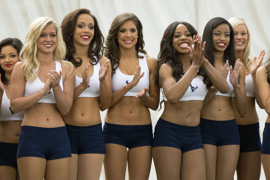 Finalists for the 2013 Houston Texans Cheeleaders applaud as former President George H.W. Bush is announced during a ceremony announcing the new squad at the Texans training facility. Photo: Smiley N. Pool, Houston Chronicle / © 2013  Houston Chronicle