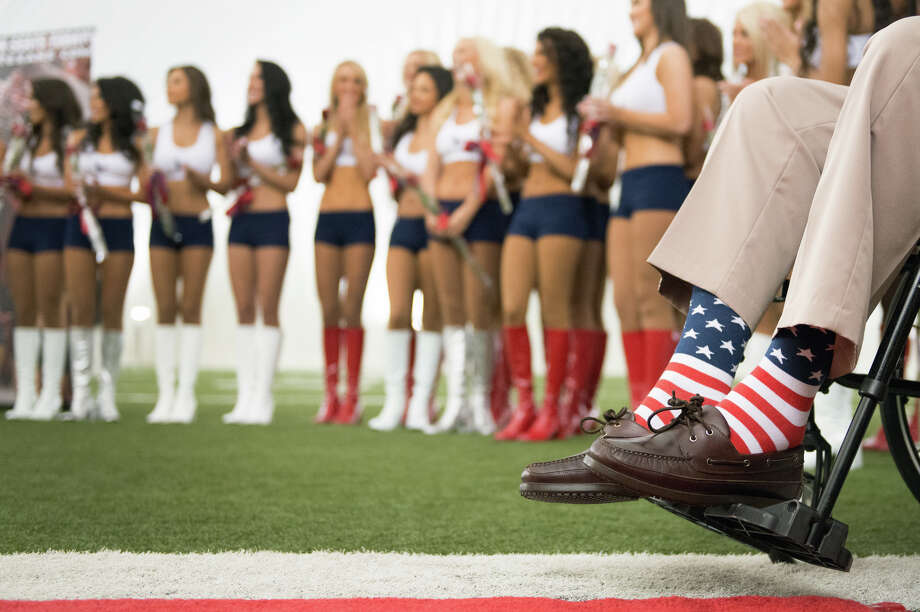 Former President George H.W. Bush wears patriotic socks during a ceremony announcing the new Houston Texans Cheerleaders squad. Photo: Smiley N. Pool, Houston Chronicle / © 2013  Houston Chronicle