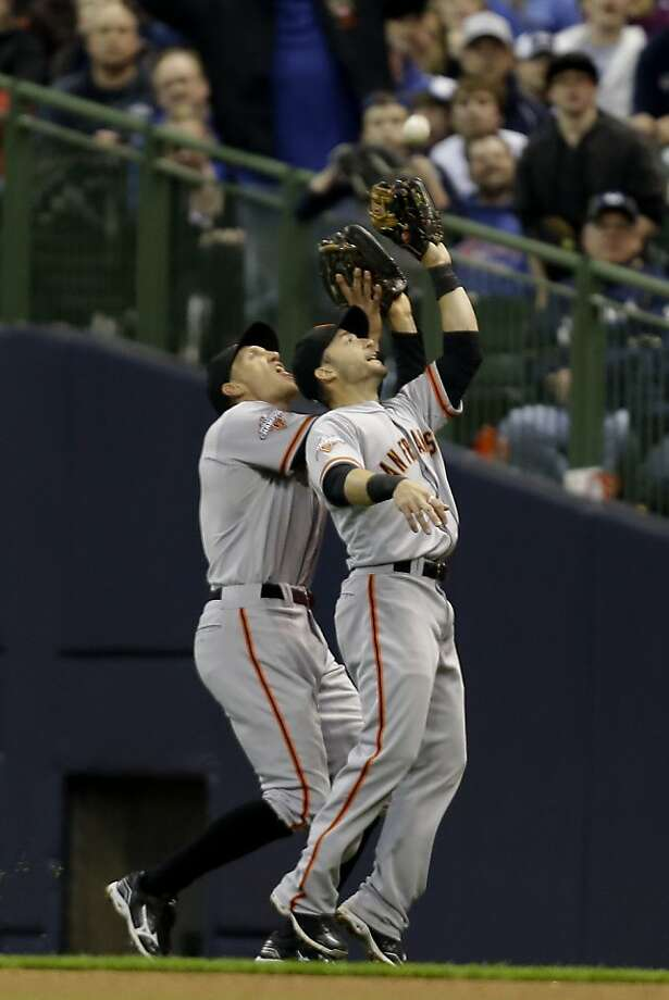 MILWAUKEE, WI - APRIL 17: Marco Scutaro #19 of the San Francisco Giants and Hunter Pence #8 collide while Scutaro makes the catch in shallow right field to retire Jonathan Lucroy of the Milwaukee Brewers during the bottom of the fourth inning at Miller Park on April 17, 2013 in Milwaukee, Wisconsin. (Photo by Mike McGinnis/Getty Images) Photo: Mike McGinnis, Getty Images