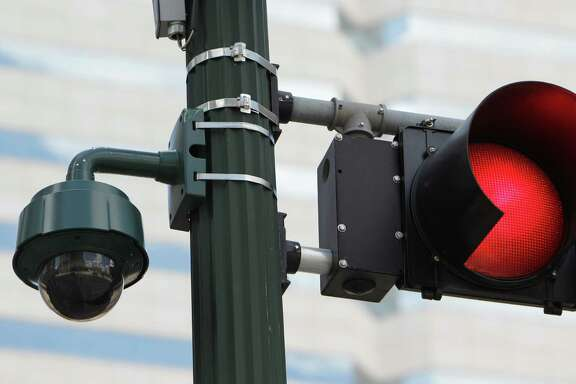 Camera watches from a traffic light downtown.