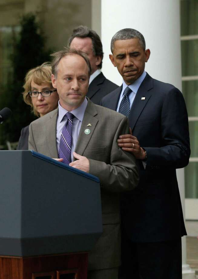 Father of Sandy Hook Elementary School shooting victim, Mark Barden introduces U.S. President Barack Obama as former U.S. Rep. Gabrielle Giffords (L) looks on in the Rose Garden of the White House on April 17, 2013 in Washington, DC. Earlier today the Senate defeated a bi-partisan measure to expand background checks for gun sales. Photo: Win McNamee, Getty Images/Win McNamee / 2013 Getty Images