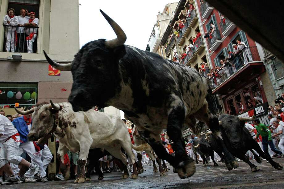 A bull takes a corner during the Running of the Bulls  in Pamplona, Spain.  A similar event is set for a Baytown raceway. Photo: Denis Doyle, Stringer / Getty Images Europe