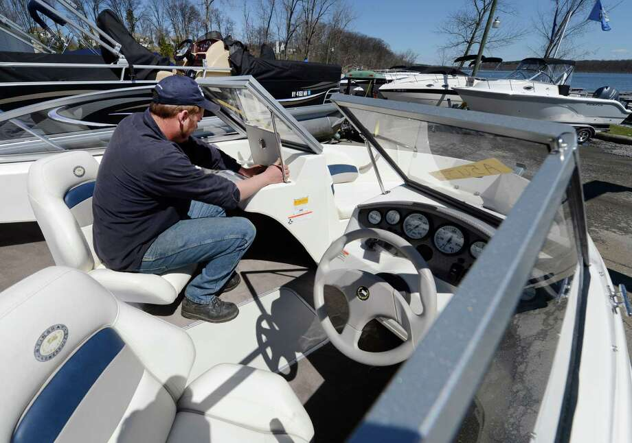 Nick Benson preps a pleasure boat for a return to the water Wednesday, April 17, 2013, at Saratoga Boat Works on Saratoga Lake, N.Y.   (Skip Dickstein/Times Union) Photo: SKIP DICKSTEIN