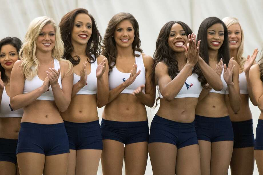 Finalists for the 2013 Houston Texans Cheeleaders applaud as former President George H.W. Bush is announced during a ceremony announcing the new squad at the Texans training facility.