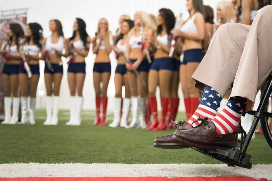 Former President George H.W. Bush wears patriotic socks during a ceremony announcing the new Houston Texans Cheerleaders squad.