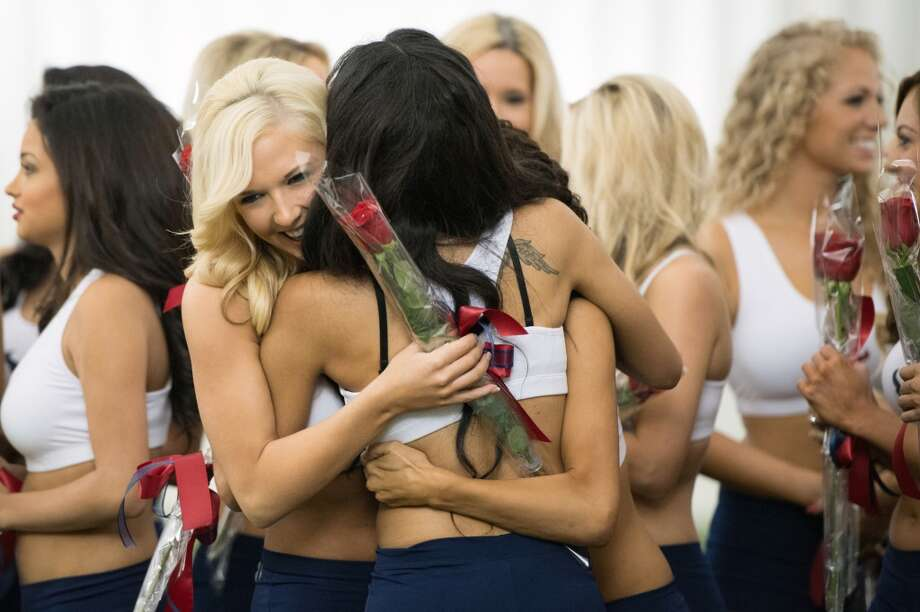 Newly announced Houston Texans cheerleaders celebrate during a ceremony announcing the new squad.