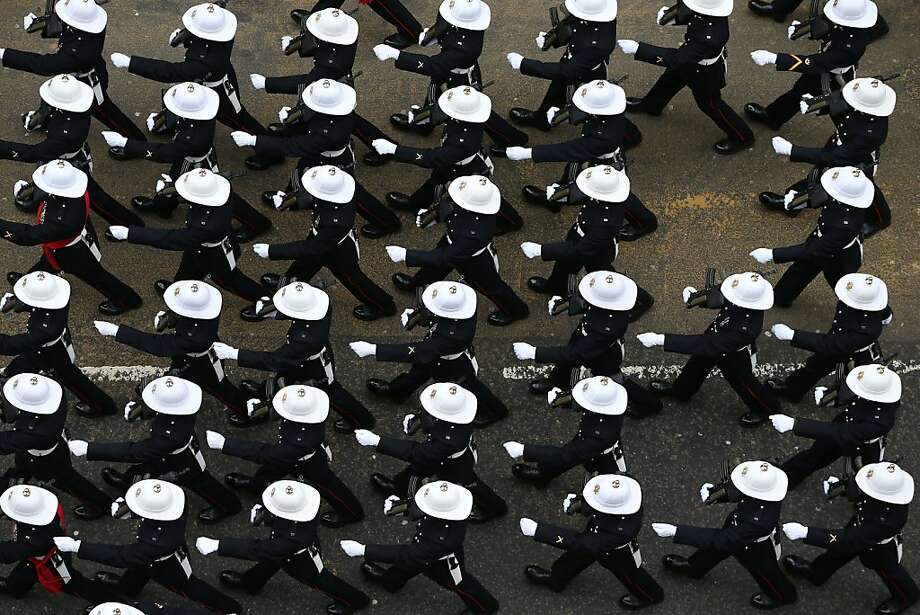LONDON, ENGLAND - APRIL 17:  Armed services personnel march along Fleet Street during the Ceremonial funeral of former British Prime Minister Baroness Thatcher on April 17, 2013 in London, England. Dignitaries from around the world today join Queen Elizabeth II and Prince Philip, Duke of Edinburgh as the United Kingdom pays tribute to former Prime Minister Baroness Thatcher during a Ceremonial funeral with military honours at St Paul's Cathedral. Lady Thatcher, who died last week, was the first British female Prime Minister and served from 1979 to 1990.  (Photo by Peter Macdiarmid/Getty Images) Photo: Peter Macdiarmid, Getty Images
