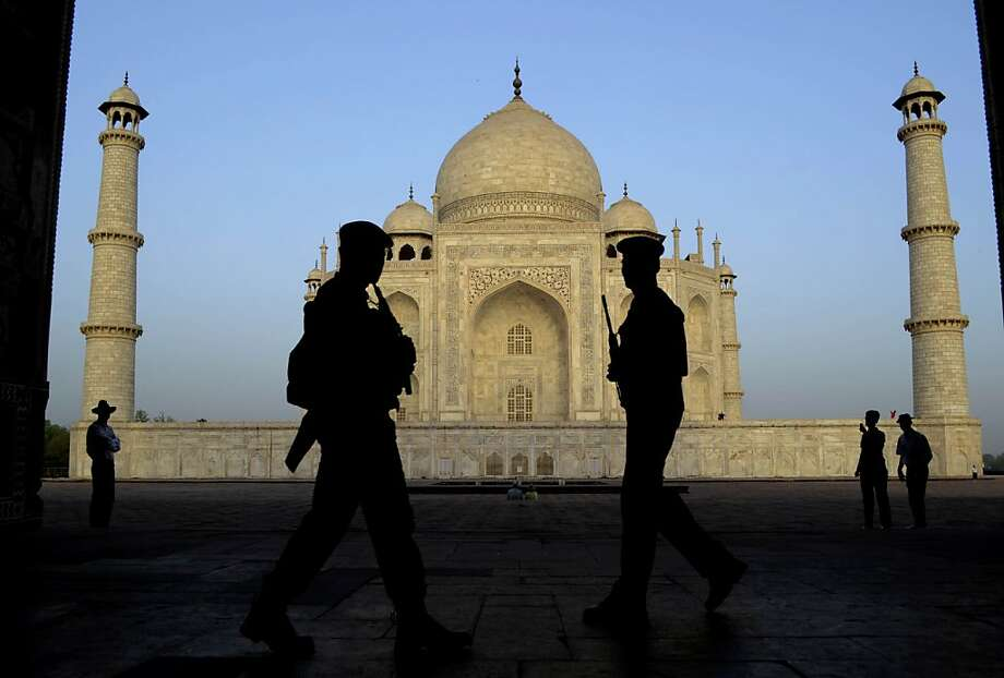 Indian paramilitary soldiers stand guard in front of the Taj Mahal in Agra, India, Wednesday, April 17, 2013. (AP Photo/Pawan Sharma) Photo: Pawan Sharma, Associated Press