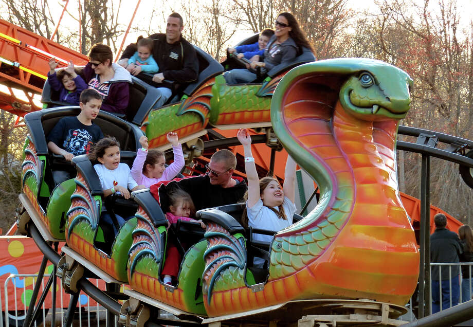 Scenes from the Trumbull Rotary Club Carnival at Hillcrest Middle School in Trumbull, Conn. on Wednesday April 17, 2013. The carnival continues through Sunday April 21st. This year, money raised will go towards building a home in Bridgeport for a vet's family through the work by the Trumbull Rotary Club and Habitat for Heroes. More information can be found at www.trumbullrotary.org and www.habitatcfc.org. Photo: Christian Abraham / Connecticut Post