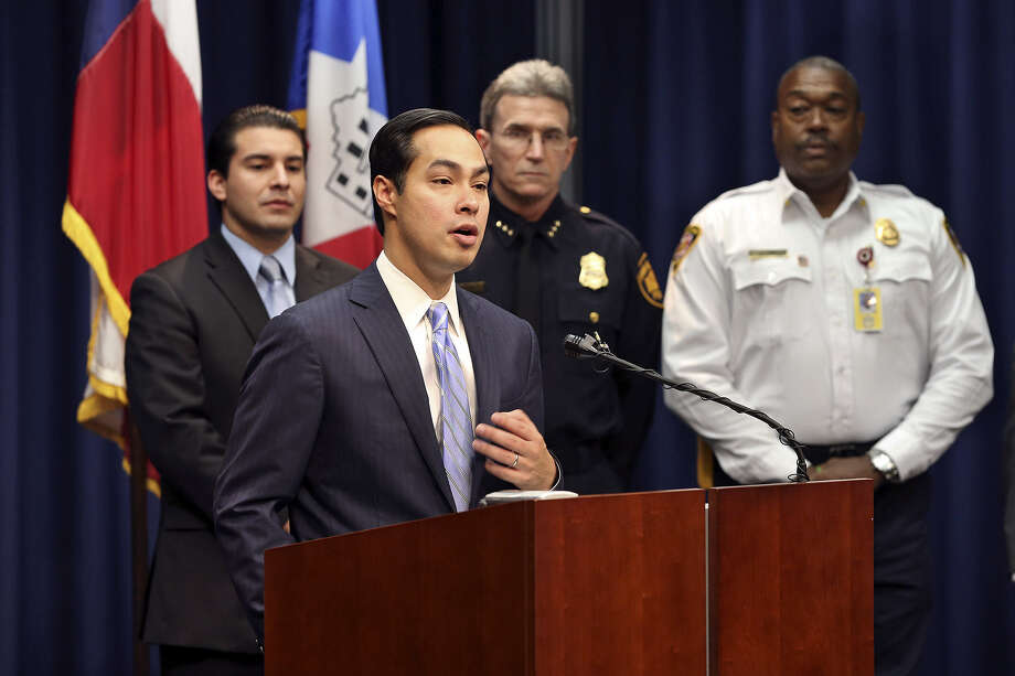 Mayor Julián Castro stands flanked by a group of city leaders to reassure San Antonians that Fiesta events will be safe and secure. Photo: Tom Reel / San Antonio Express-News