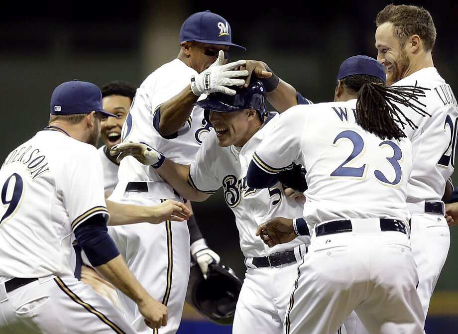 Milwaukee Brewers' Blake Lalli is mobbed by teammates after hitting a game-winning walk off single during the ninth inning of a baseball game against the San Francisco Giants Wednesday, April 17, 2013, in Milwaukee. The Brewers won 4-3. (AP Photo/Morry Gash) Photo: Morry Gash, Associated Press