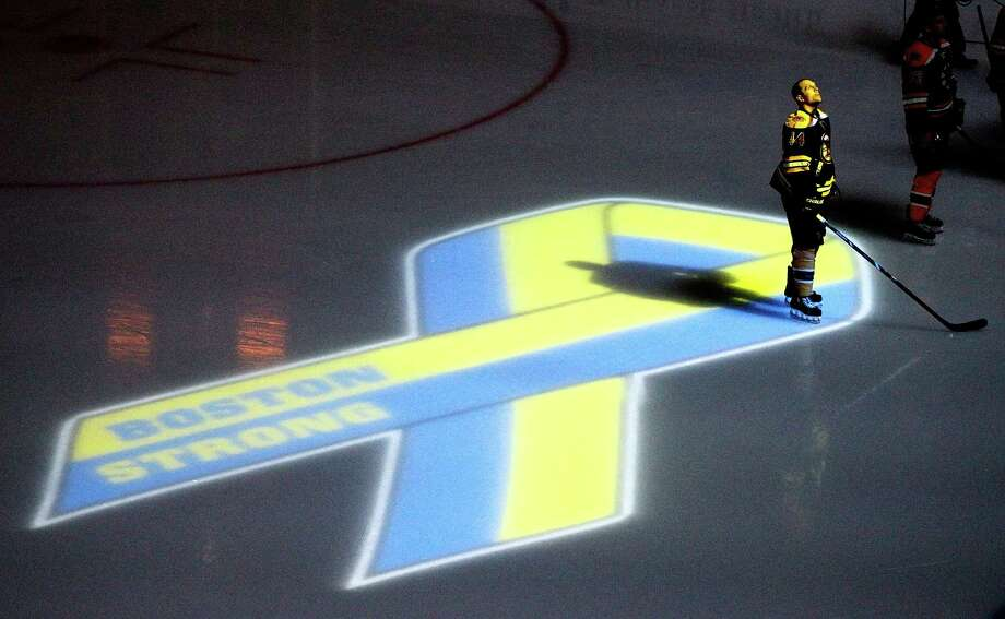 BOSTON, MA - APRIL 17:  Dennis Seidenberg #44 of the Boston Bruins stands near aa projection of the Boston Marathon Memorial Ribbon seen on the ice during pre game ceremonies in remembrance of the Boston Marathon bombing victims before a game between the Buffalo Sabres and the Boston Bruins at TD Garden on April 17, 2013 in Boston, Massachusetts.  (Photo by Jim Rogash/Getty Images) Photo: Jim Rogash
