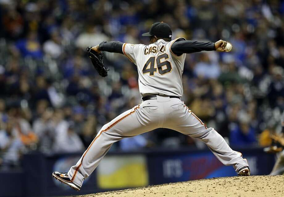 San Francisco Giants relief pitcher Santiago Casilla throws during the eighth inning of a baseball game against the Milwaukee Brewers Wednesday, April 17, 2013, in Milwaukee. (AP Photo/Morry Gash) Photo: Morry Gash, Associated Press