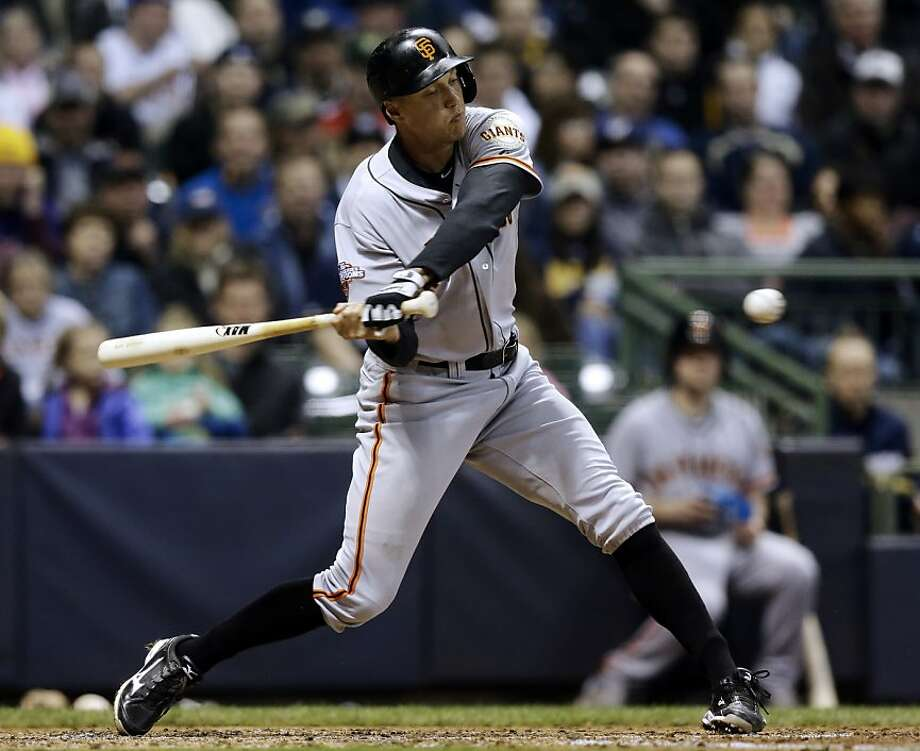 San Francisco Giants' Hunter Pence hits a two-run single during the sixth inning of a baseball game against the Milwaukee Brewers Wednesday, April 17, 2013, in Milwaukee. (AP Photo/Morry Gash) Photo: Morry Gash, Associated Press