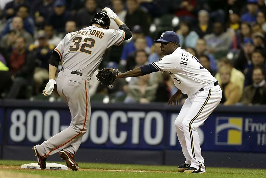 MILWAUKEE, WI - APRIL 17: Yuniesky Betancourt #3 of the Milwaukee Brewers tag out Ryan Vogelsong #32 as he runs to first base in the top of the seventh inning against the San Francisco Giants at Miller Park on April 17, 2013 in Milwaukee, Wisconsin. (Photo by Mike McGinnis/Getty Images) Photo: Mike McGinnis, Getty Images