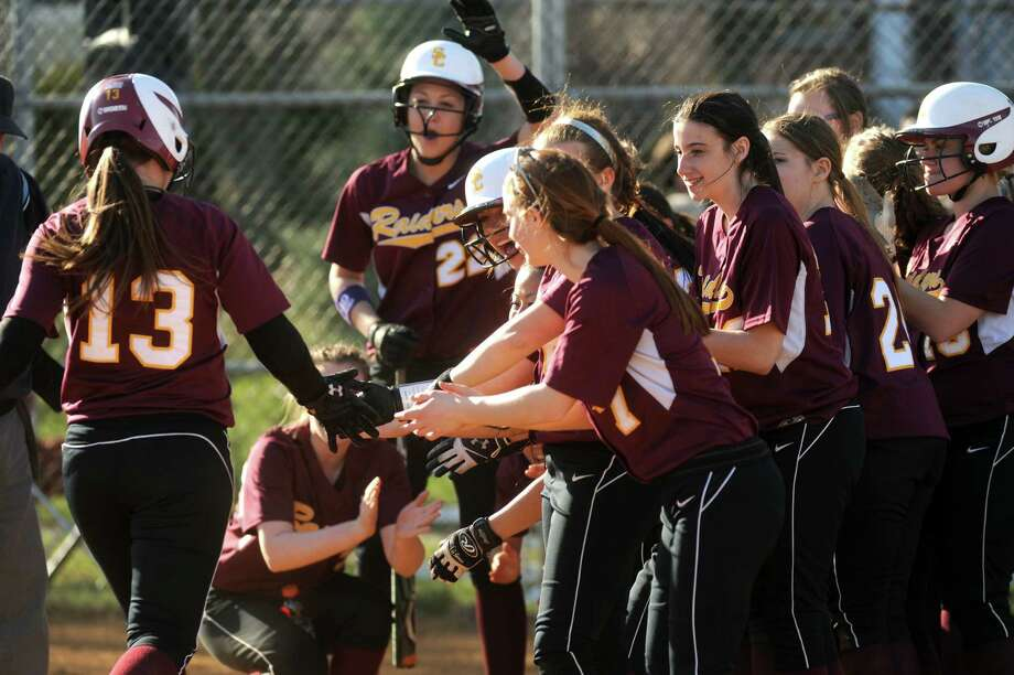 Colonie's Kelly Lane is congratulated by teammates after hitting a home run during their high school girl's softball game against Shenendehowa on Wednesday April 17, 2013 in Colonie, N.Y. (Michael P. Farrell/Times Union) Photo: Michael P. Farrell