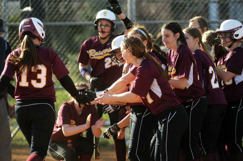 Colonie's Kelly Lane is congratulated by teammates after hitting a home run during their high school
